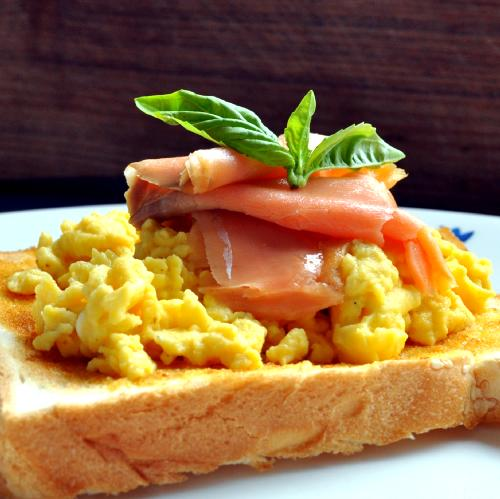 Place the scrambled eggs on top of the Toast in a neat pile. Top the ...